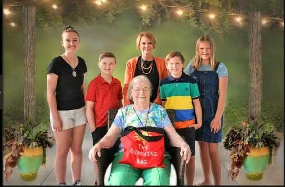 """From back row left to right, the family involved in a new intergenerational children's book, """"Ms. Ruby and the Gigi Squad: Friendships Come in All Ages,"""" is Avery, 15, Will, 10, author Vickie Rodgers, who is the children's grandmother lovingly referred to as """"Gigi,"""" Cole, 10, and Caroline, 12. Front row, a good friend to Rodgers, Ruby Foster, was the inspiration for the book."""