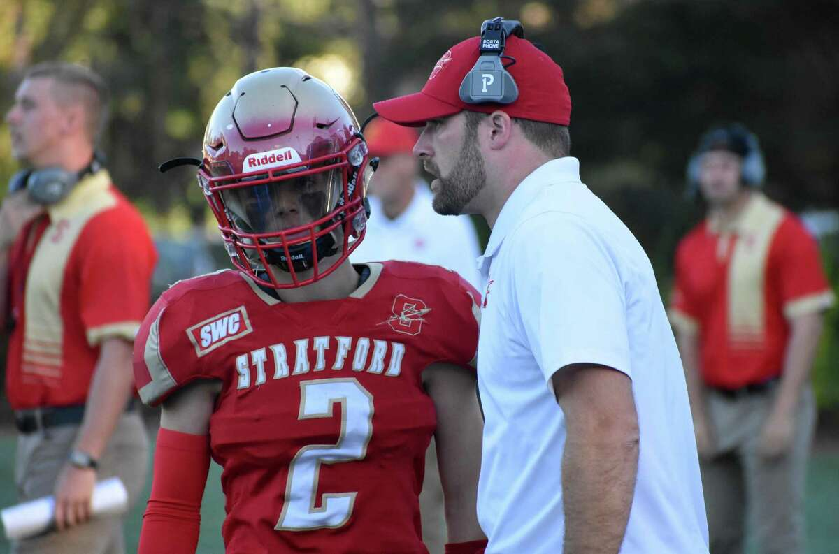 Stratford coach Nathan Tyler talks to quarterback Joseph Booska during a football game between Bridgeport Central and Stratford at Penders Field, Stratford on Friday, Oct. 1, 2021.