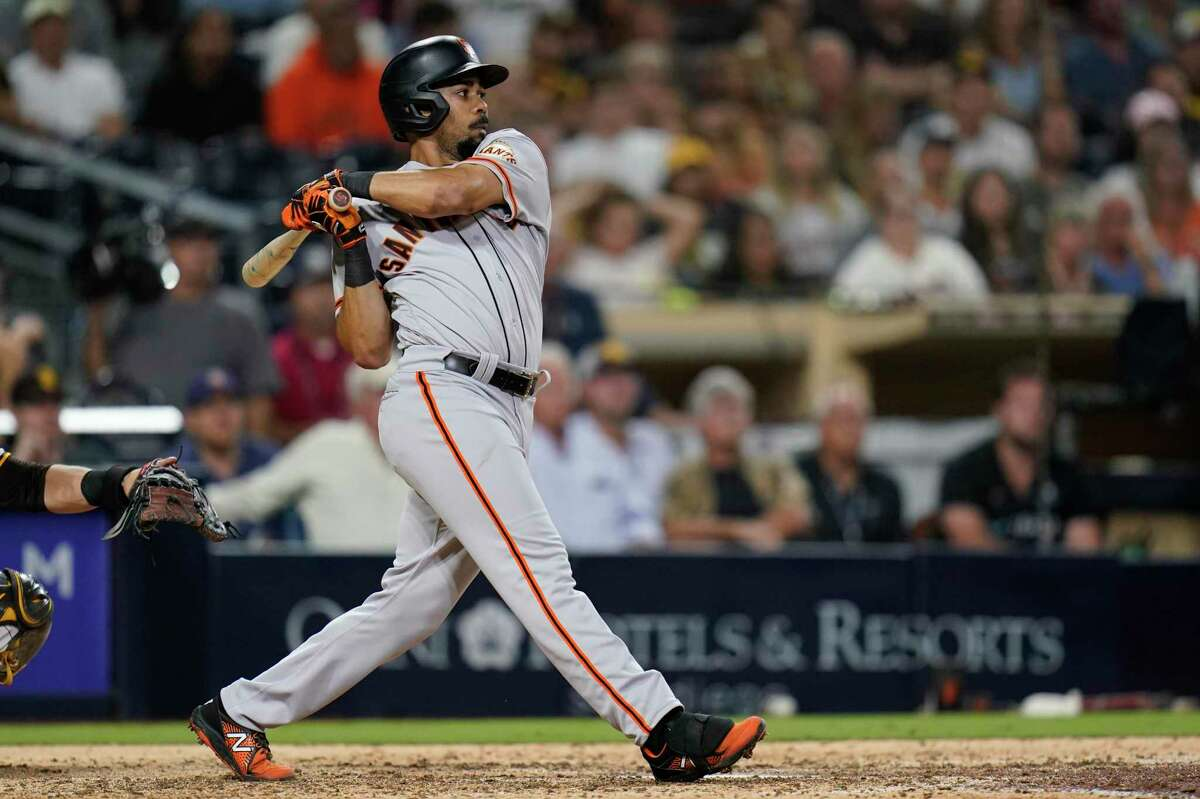 San Francisco Giants' LaMonte Wade Jr. watches his RBI-single hit during the ninth inning of a baseball game against the San Diego Padres, Tuesday, Sept. 21, 2021, in San Diego. (AP Photo/Gregory Bull)