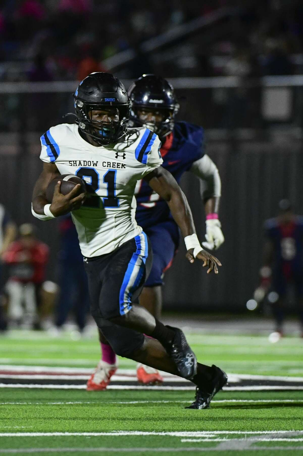 Shadow Creek's Felix Buchanan (21) runs the ball against Dawson during the first half of a District 23-6A high school football game at Pearland ISD Stadium on Friday, Oct. 1, 2021, in Pearland, Texas.