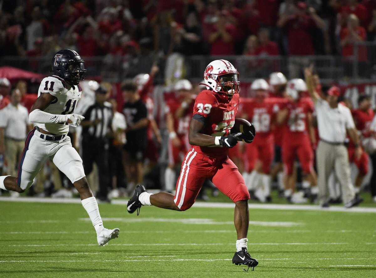 Katy running back Seth Davis (23) runs past Tompkins defensive back Samuel Kale (11) for a touchdown during the second half of a high school football game, Friday, Oct. 1, 2021, in Katy.