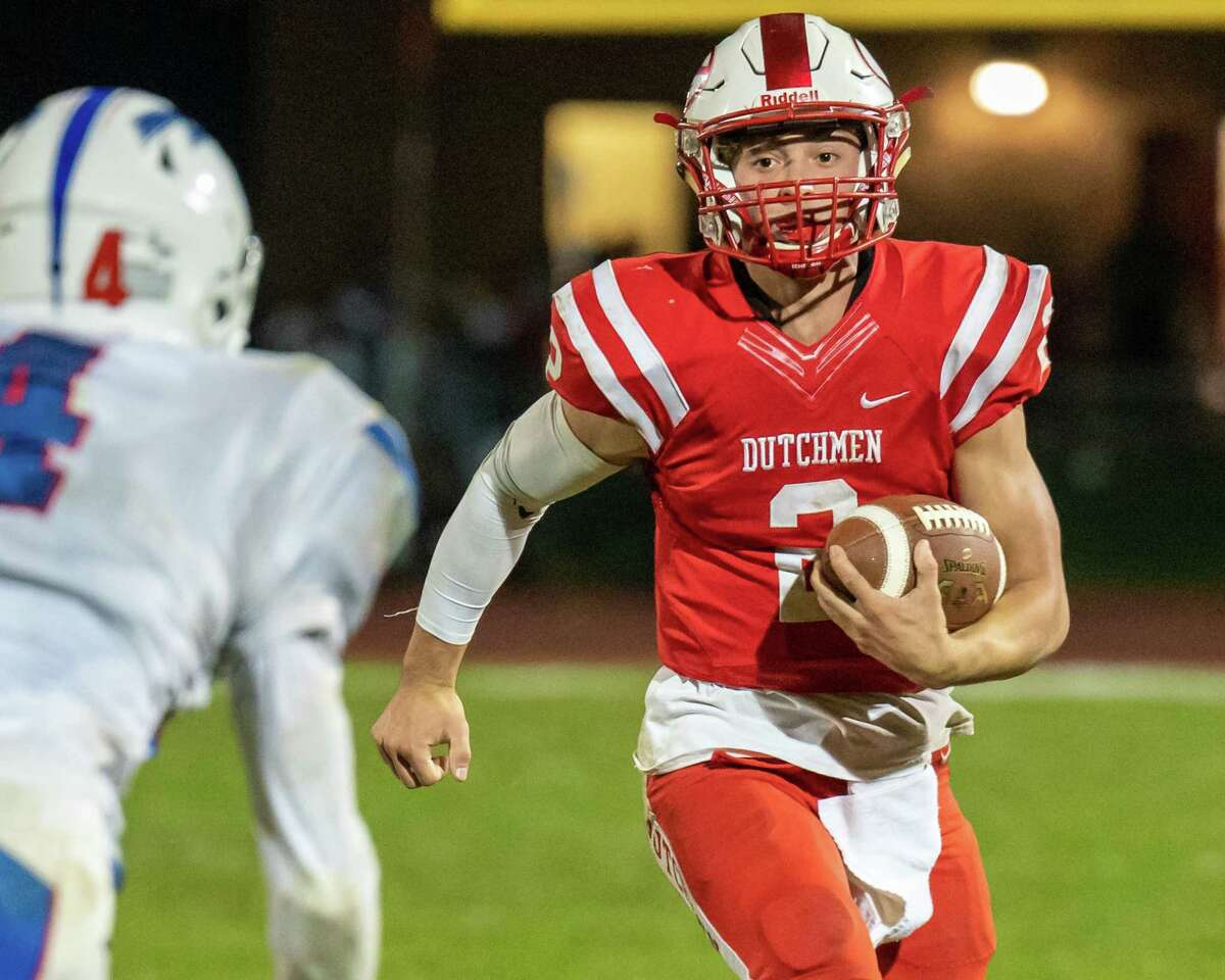 Guilderland quarterback Ty Santabarbara looks for running room during a Class AA matchup against Saratoga at Guilderland High School on Friday, Oct. 1, 2021. (Jim Franco/Special to the Times Union)