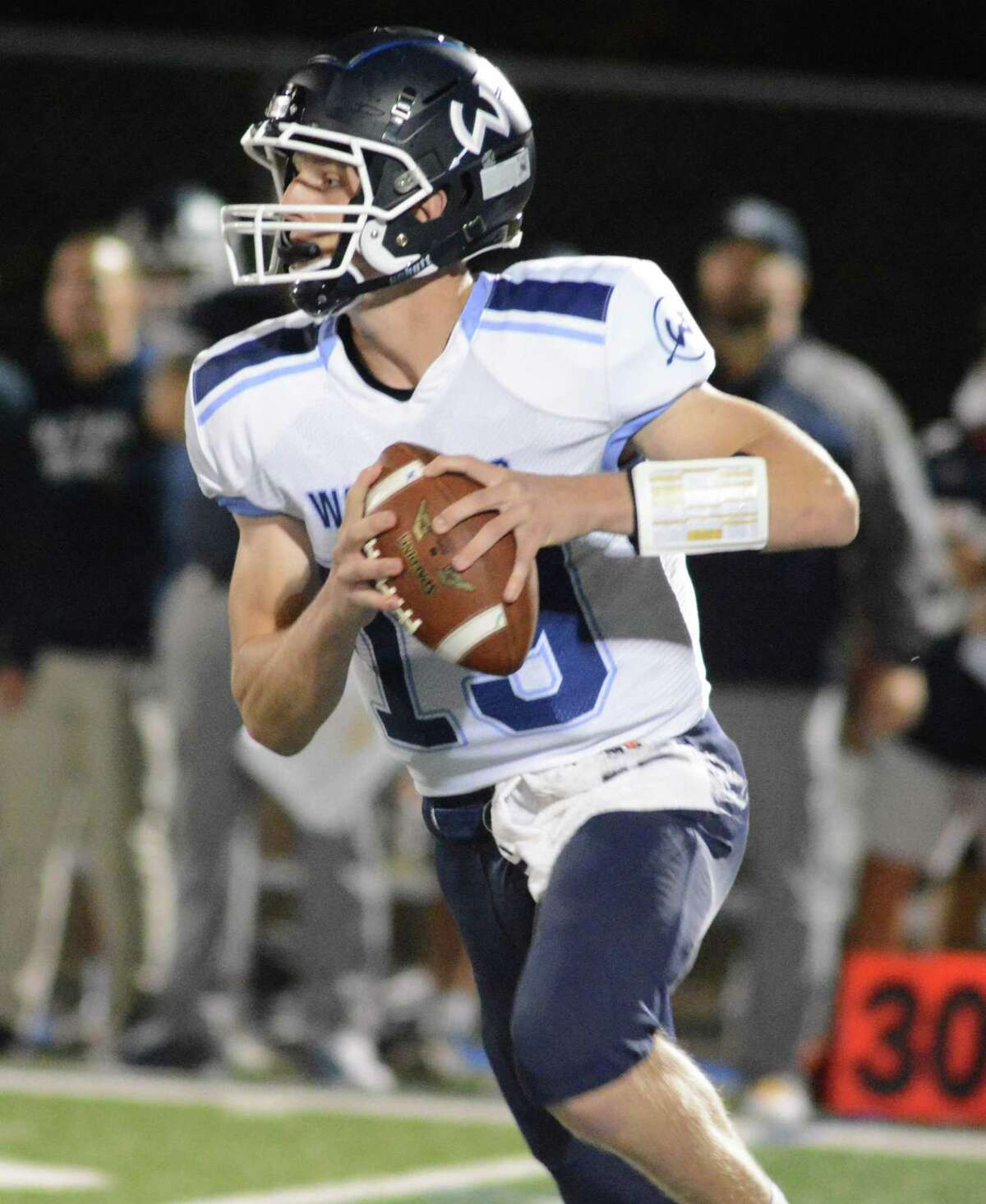 Wilton quarterback Grant Masterson looks to pass during a football game Friday night.