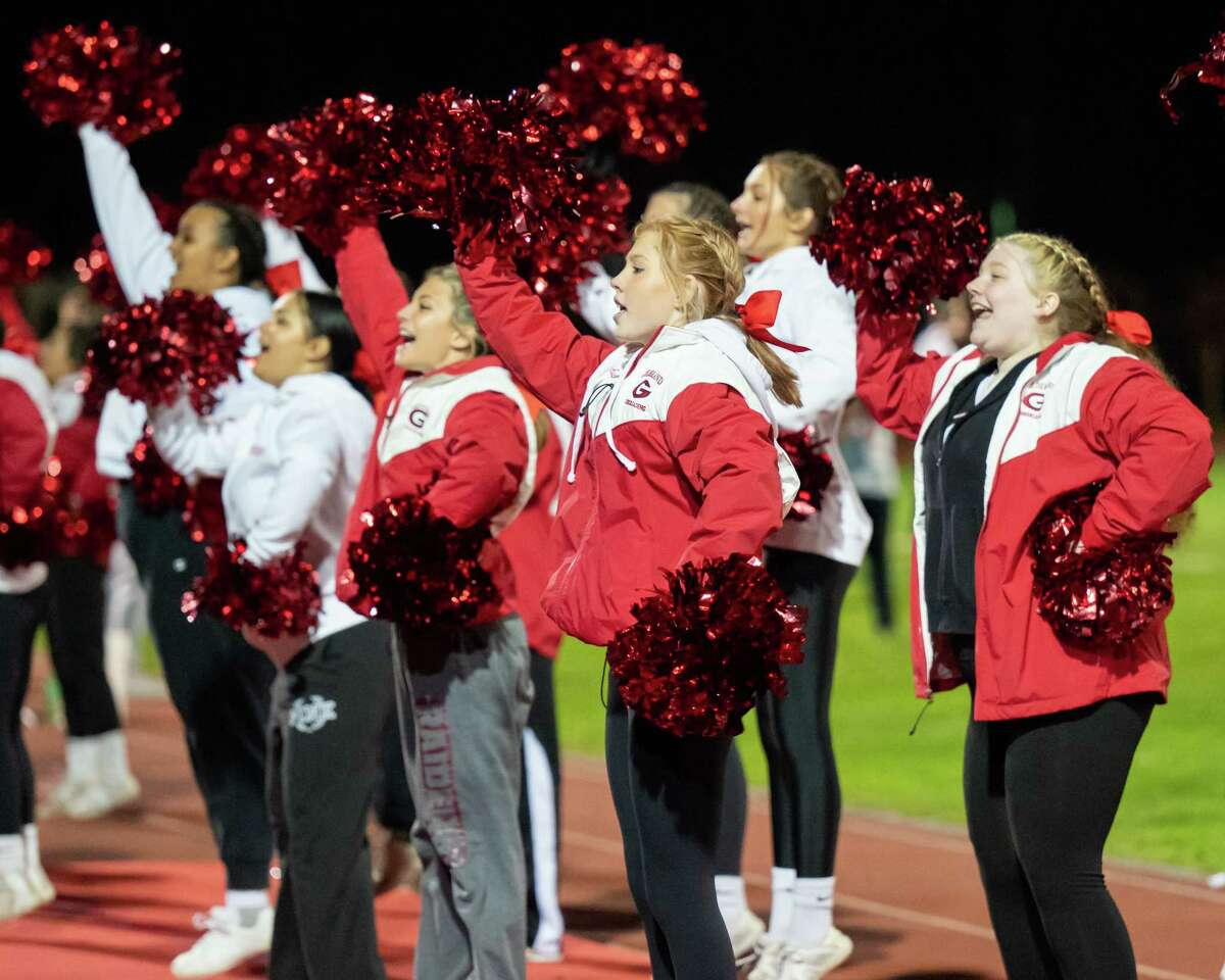 The Guilderland cheerleaders cheer for their team during a Class AA matchup against Saratoga at Guilderland High School on Friday, Oct. 1, 2021. (Jim Franco/Special to the Times Union)