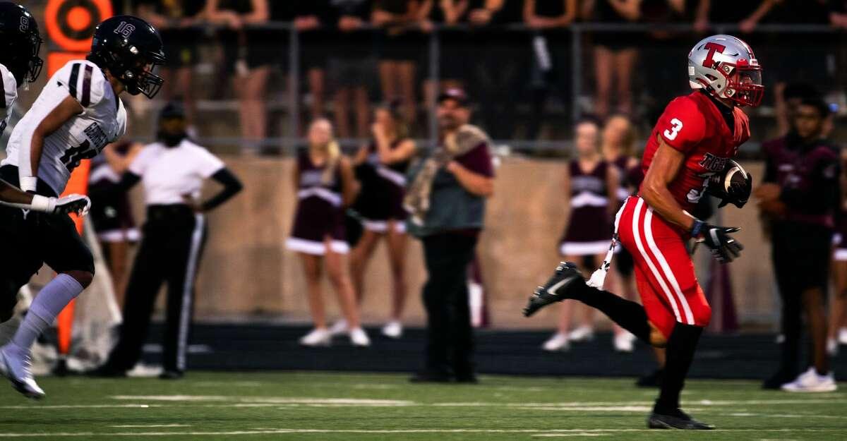 Travis Tigers' wide receiver Gabriel Van Wyk runs the ball against the George Ranch High School Longhorns, Friday, Oct. 1, 2021, in Missouri City.