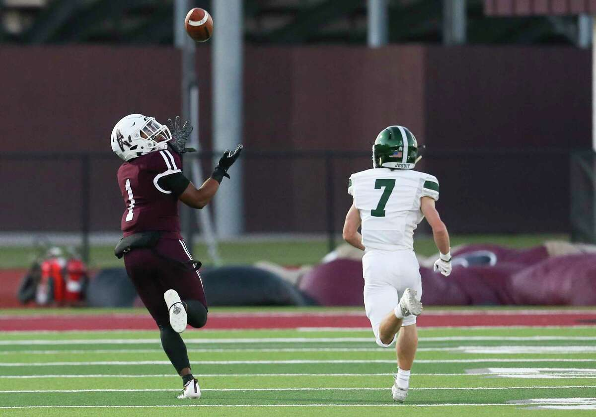 Pearland wide receiver Izeal Jones, shown here against Strake Jesuit, caught three touchdown passes Friday night to power the Oilers past Alvin.