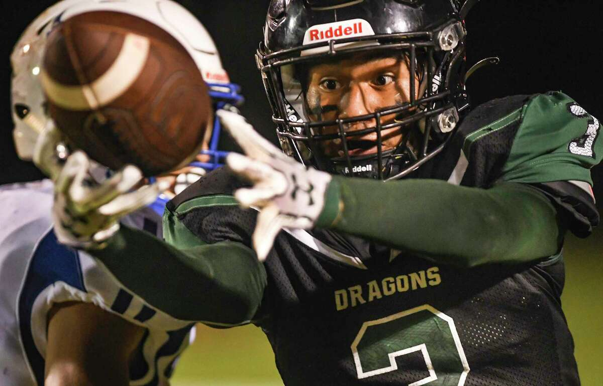 Receiver Trey Cano of Southwest watches the ball intently as he catches it, but is ruled out of bounds during high school football action against Laredo Cigarroa at Southwest High Dragon Stadium on Friday, Oct. 1, 2021.