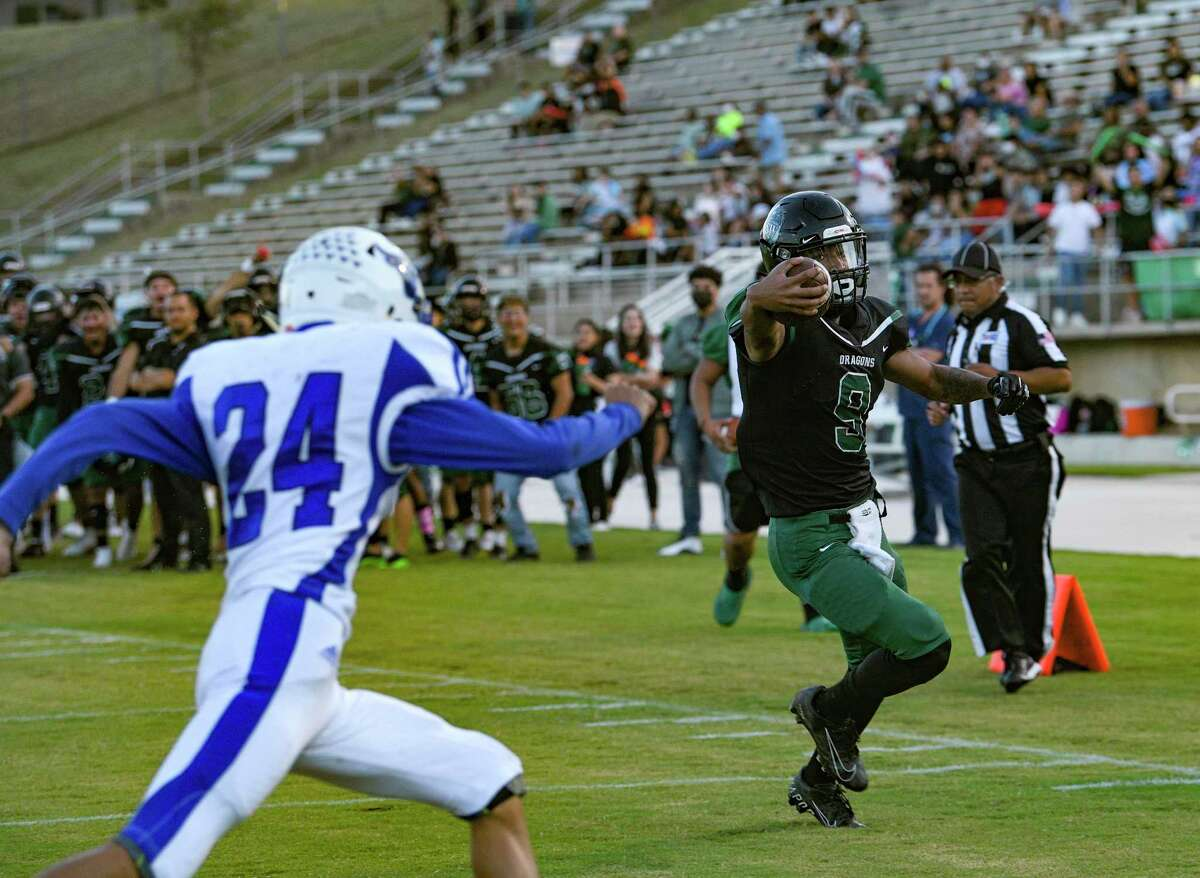 Southwest's Lloyd Young scores as Raul Quinones of Laredo Cigarroa chases him during high school football action at Southwest High Dragon Stadium on Friday, Oct. 1, 2021.