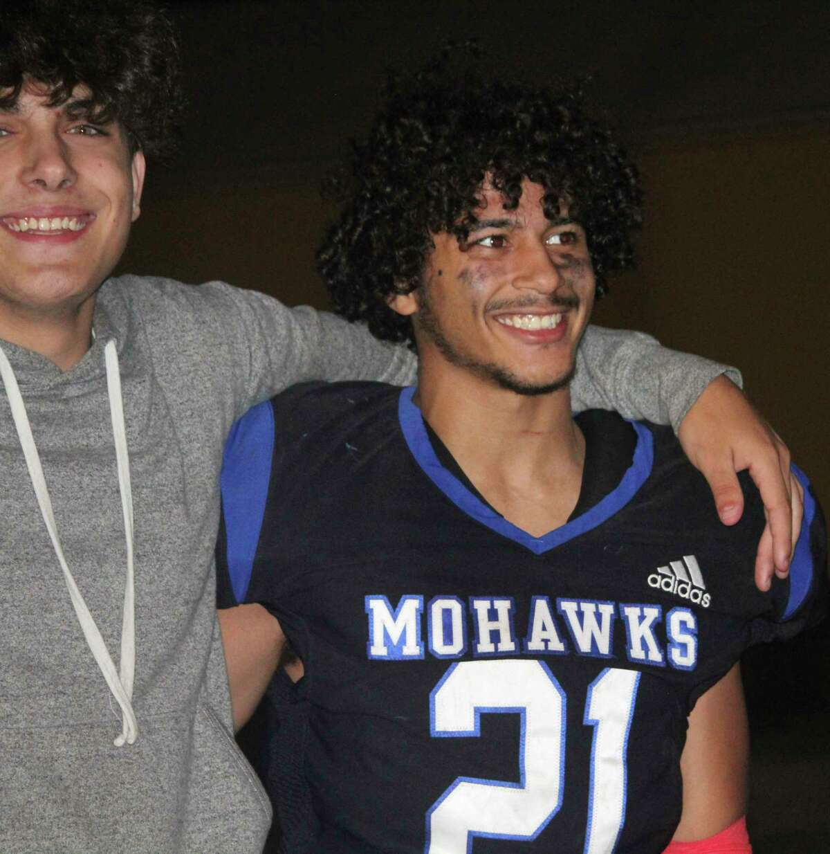 Morley Stanwood's Jaqorri Vermaas (right) and friends are smiling about a four-game Mohawk football winning streak. (Pioneer photo/John Raffel)