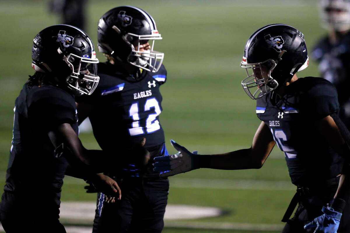 New Caney running back Arkez Gomez (4) celebrates with wide receiver Kendall Dove (16) after scoring a 21-yard touchdown to give the Eagles a 31-27 lead during the fourth quarter of a high school football game at Randall Reed Stadium, Friday, Oct. 1, 2021, in New Caney.