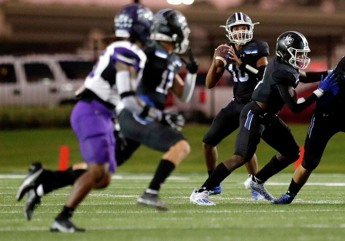 New Caney quarterback Cornelius Banks (10) throws a 51-yard touchdown pass to wide receiver Blaine Lucas (12) during the first quarter of a high school football game at Randall Reed Stadium, Friday, Oct. 1, 2021, in New Caney.