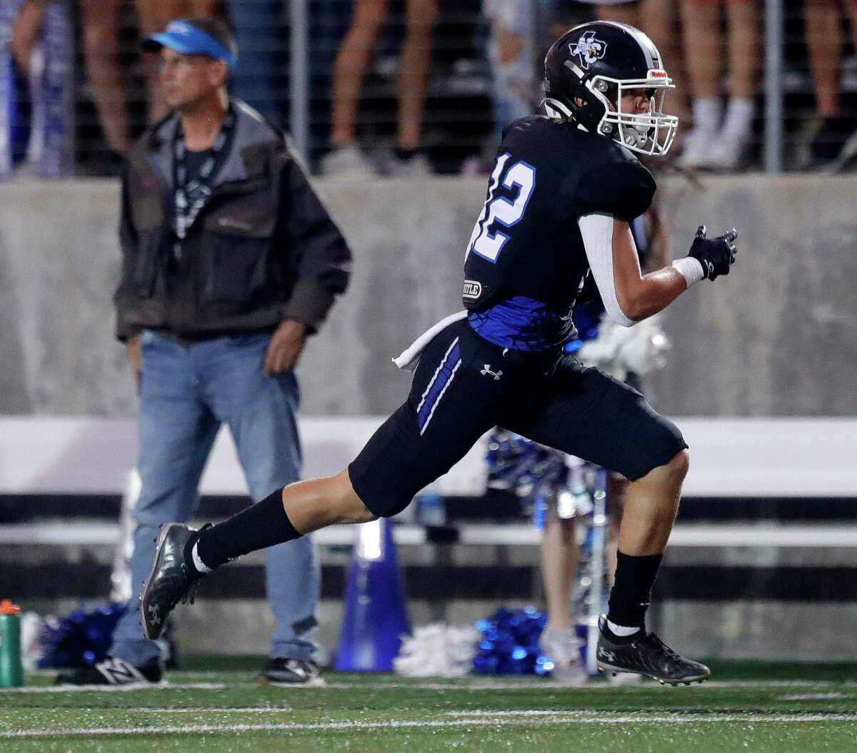 New Caney wide receiver Blaine Lucas (12) runs for a 51-yard touchdown during the first quarter of a high school football game at Randall Reed Stadium, Friday, Oct. 1, 2021, in New Caney.