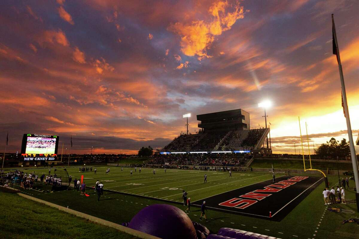 The sun sets as the New Caney Eagles take on the Lufkin Panthers during the second quarter of a high school football game at Randall Reed Stadium, Friday, Oct. 1, 2021, in New Caney.