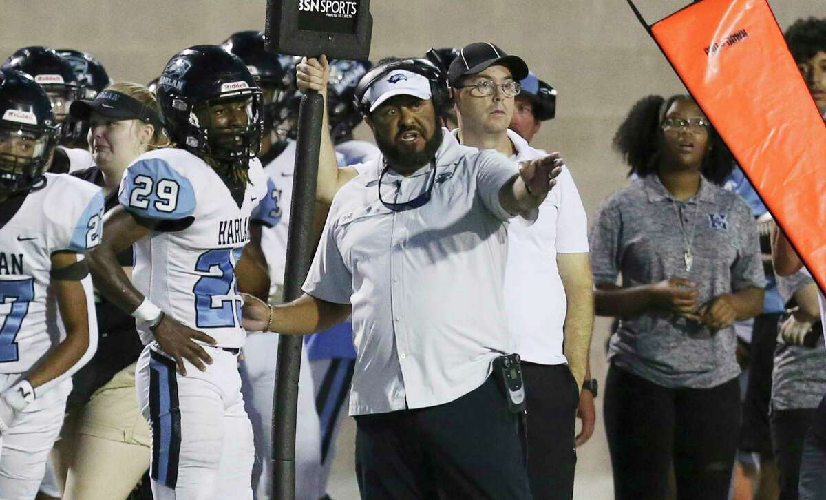 Harlan head coach Eddie Salas (center) directs his team against O'Connor during their football game at Farris Stadium on Friday, Oct. 1, 2021.