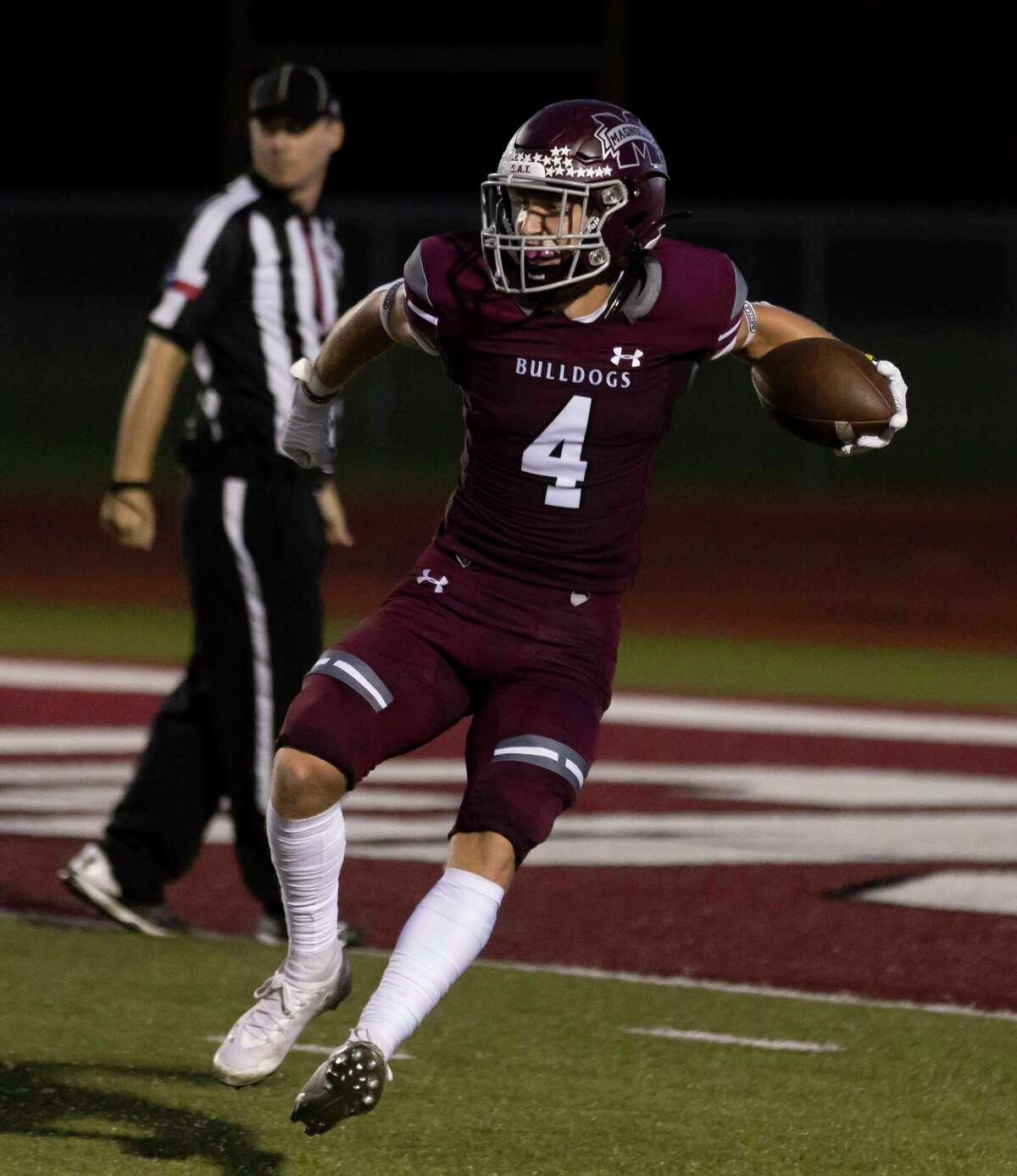 #4 of Magnolia reacts after he scores a touchdown during the first quarter of a District 8-5A (Div. I) football game against Caney Creek at Bulldog Stadium, Friday, Oct. 10, 2021, in Magnolia.