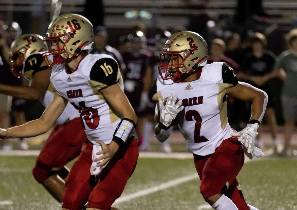 Caney Creek wide receiver John Milo (2) runs the ball during the first quarter of a District 8-5A (Div. I) football game against Magnolia at Bulldog Stadium, Friday, Oct. 10, 2021, in Magnolia.