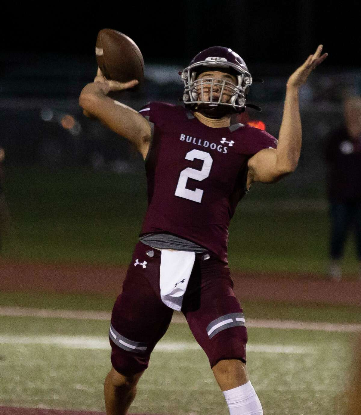 #2 of Magnolia throws during the first quarter of a District 8-5A (Div. I) football game against Caney Creek at Bulldog Stadium, Friday, Oct. 10, 2021, in Magnolia.