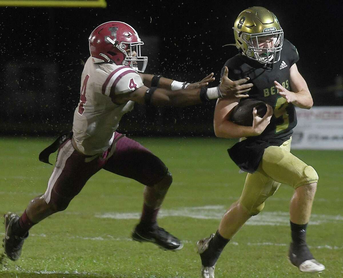 Little Cypress-Mauriceville's Ashton Landry tries to elude the tackle by Jasper's TyAnthony Smith during Friday's game at LC-M. Photo made Friday, October 1, 2021 Kim Brent/The Enterprise