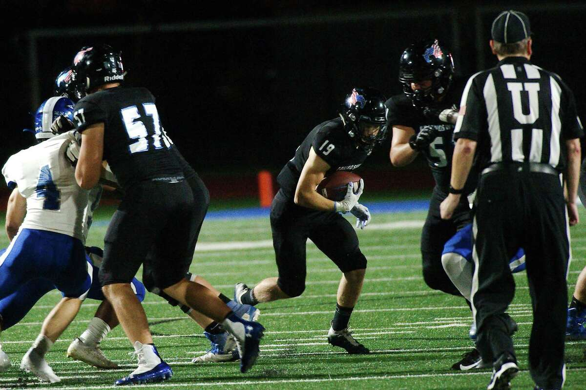 Friendswood's Jackson Rhodes (19) looks for a hole in the Baytown Sterling defense Baytown Friday, Oct. 1, 2021 at Friendswood High School.