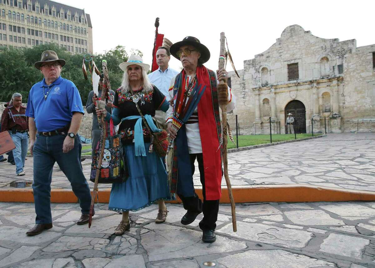 Ramón Vásquez y Sánchez (right) and his wife, Maria Chavez Vásquez, walk with State Rep. Leo Pacheco (left) and State Sen. Jose Mendendez in a procession as a local Native American group honored buried descendants during their 25th Annual Sunrise Ceremony at the Alamo on Saturday, Sept. 7, 2019. Archaeologists believe they may have pinpointed the location of the first church and cemetery of the Mission San Antonio de Valero, at the north end of Alamo Plaza.