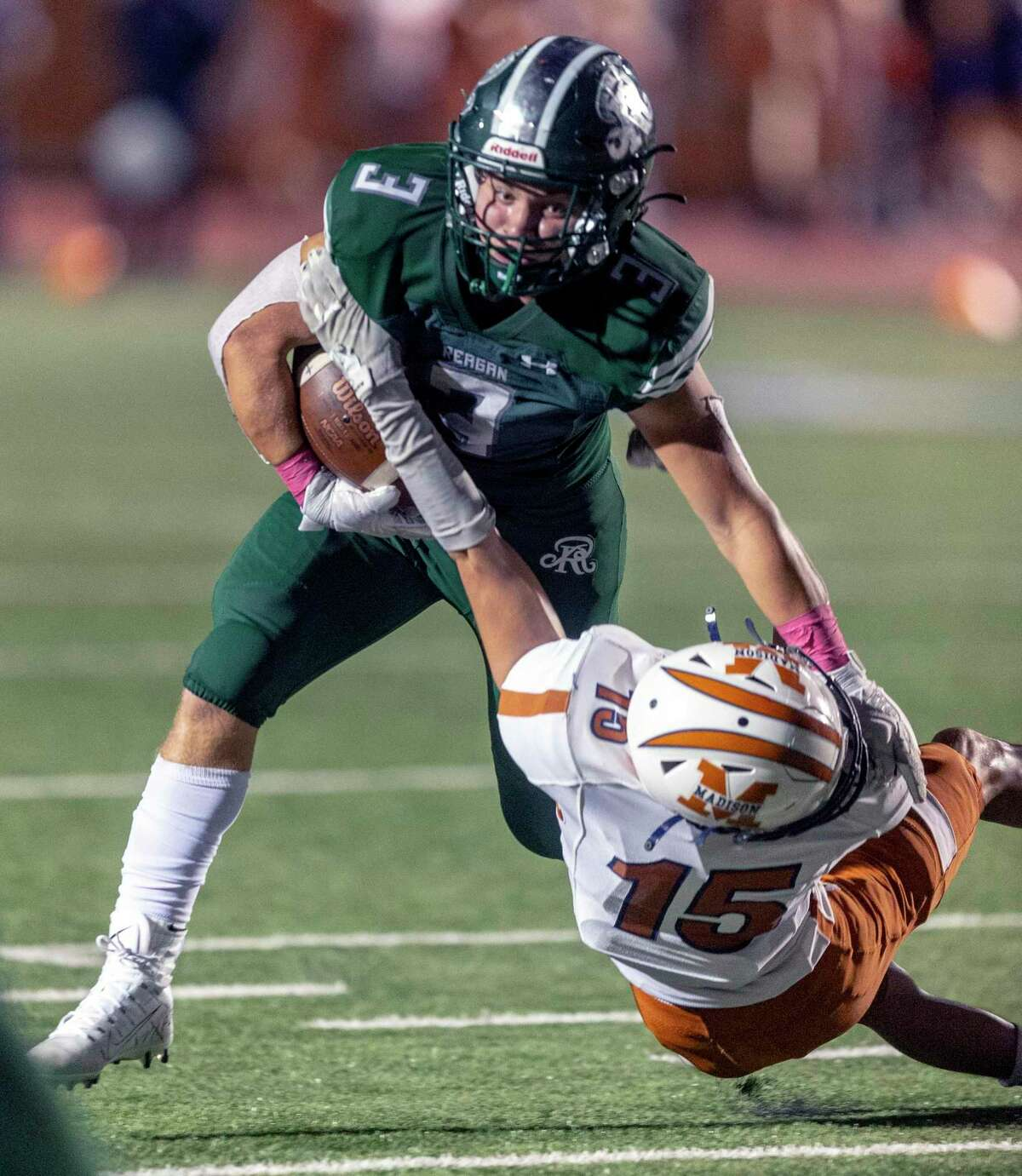 Reagan's Javier Colsa tries Friday, Oct. 1, 2021 to break away from Madison's Damian Mendoza during the first half of the Rattlers' game against the Mavericks.