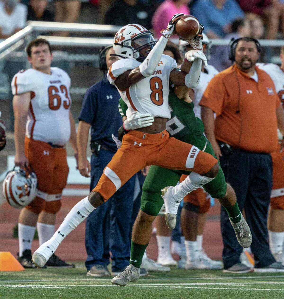 Madison defensive back Demetreon Delane almost intercepts a pass Friday, Oct. 1, 2021 intended for Reagan's Tre'Shawn Jones during the first half of the Mavericks' game against the Rattlers at Heroes Stadium.