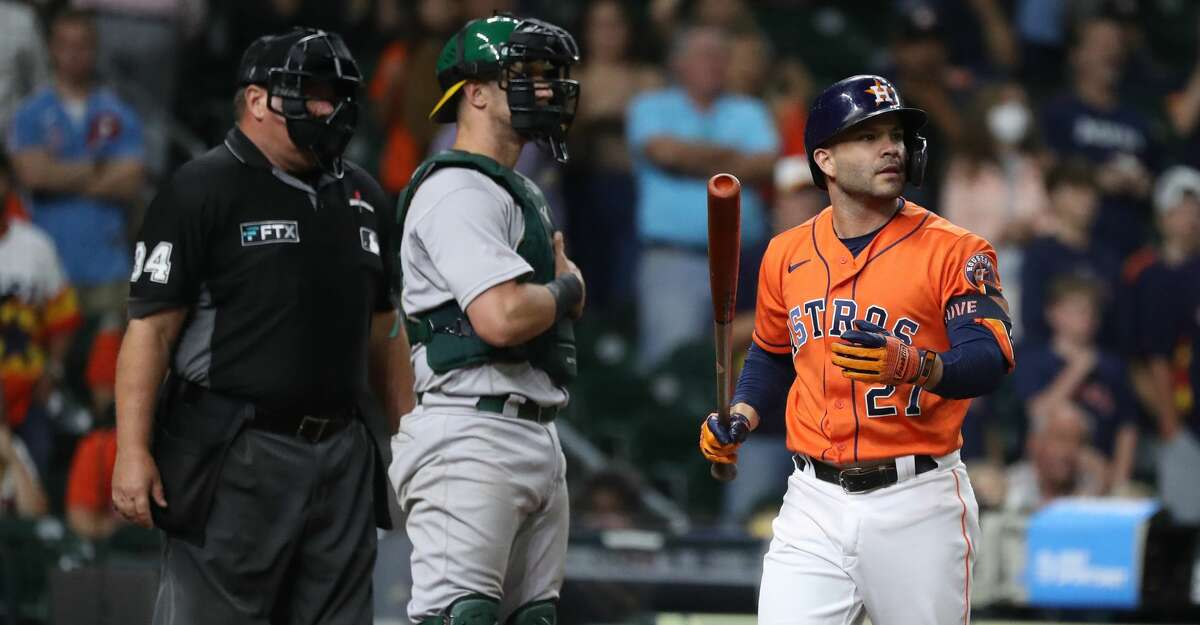 Houston Astros pinch hitter Jose Altuve (27) strikes out against Oakland Athletics relief pitcher Lou Trivino (62) during the ninth inning of an MLB baseball game at Minute Maid Park, Friday, October 1, 2021, in Houston.
