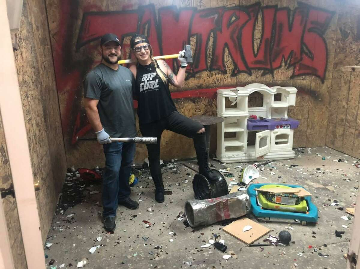 Customers use instruments like baseball bats and sledgehammers to break things in Tantrum's rage rooms.