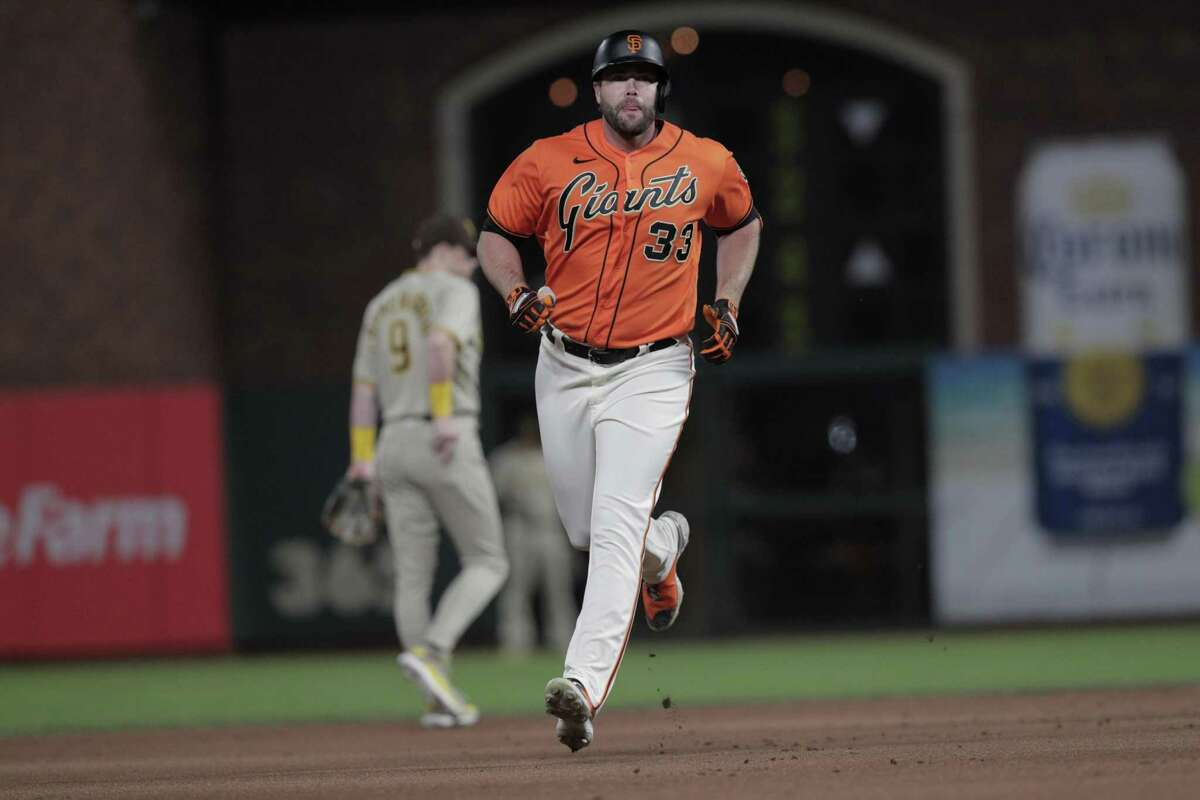 Darin Ruf rounds the bases after hitting a solo home run in the first inning against the Padres at Oracle Park on Friday night. Ruf has had a late-career career year for the Giants.