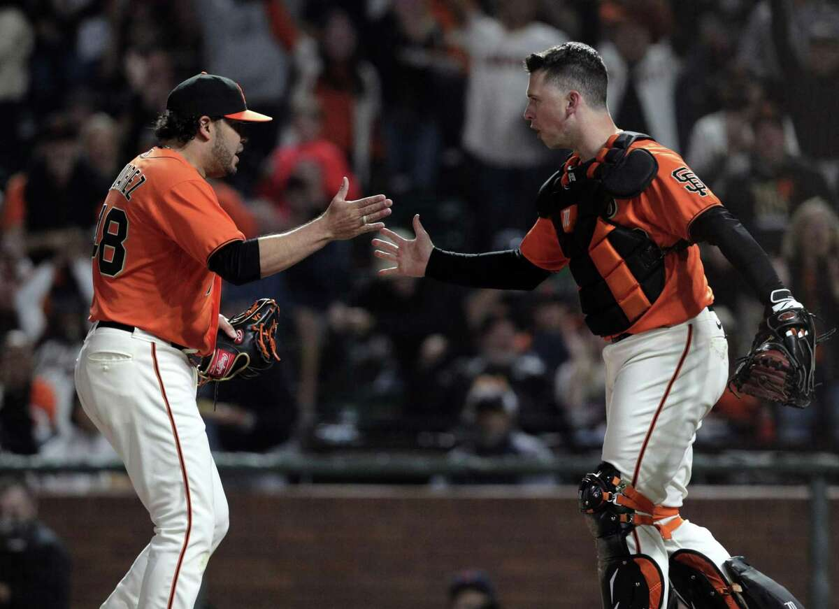 Buster Posey (28) and pitcher Jose Alvarez (48) react to Fernando Tatis Jr. (23) being tagged out in a rundown by Evan Longoria (10) in the sixth inning to keep the Padres from scoring as the San Francisco Giants played the San Diego Padres at Oracle Park in San Francisco, Calif., on Friday, October 1, 2021.,