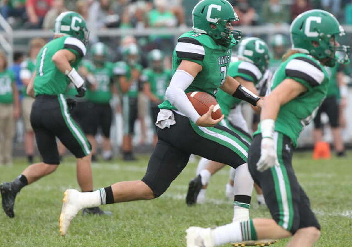 Carrollton's Grant Pohlman Pohlman rushed for 140 yards and two touchdowns and threw for another 191 yards and two scores to Kyle Leonard as the Hawks built up a 21-0 halftime leads and held off Greenfield 34-16 for a WIVC South win Friday in Carrollton.
