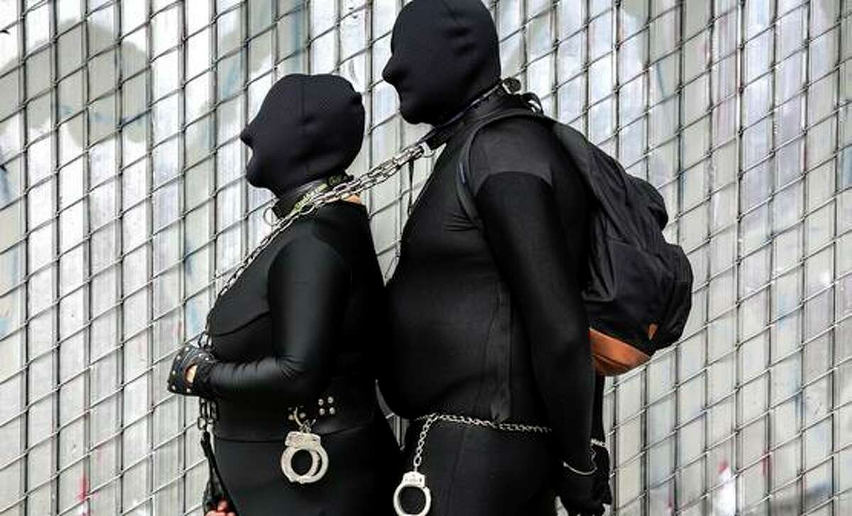 A couple, who chose to remain anonymous, stand for a photo in San Francisco on Sunday, Sept. 26, 2021.