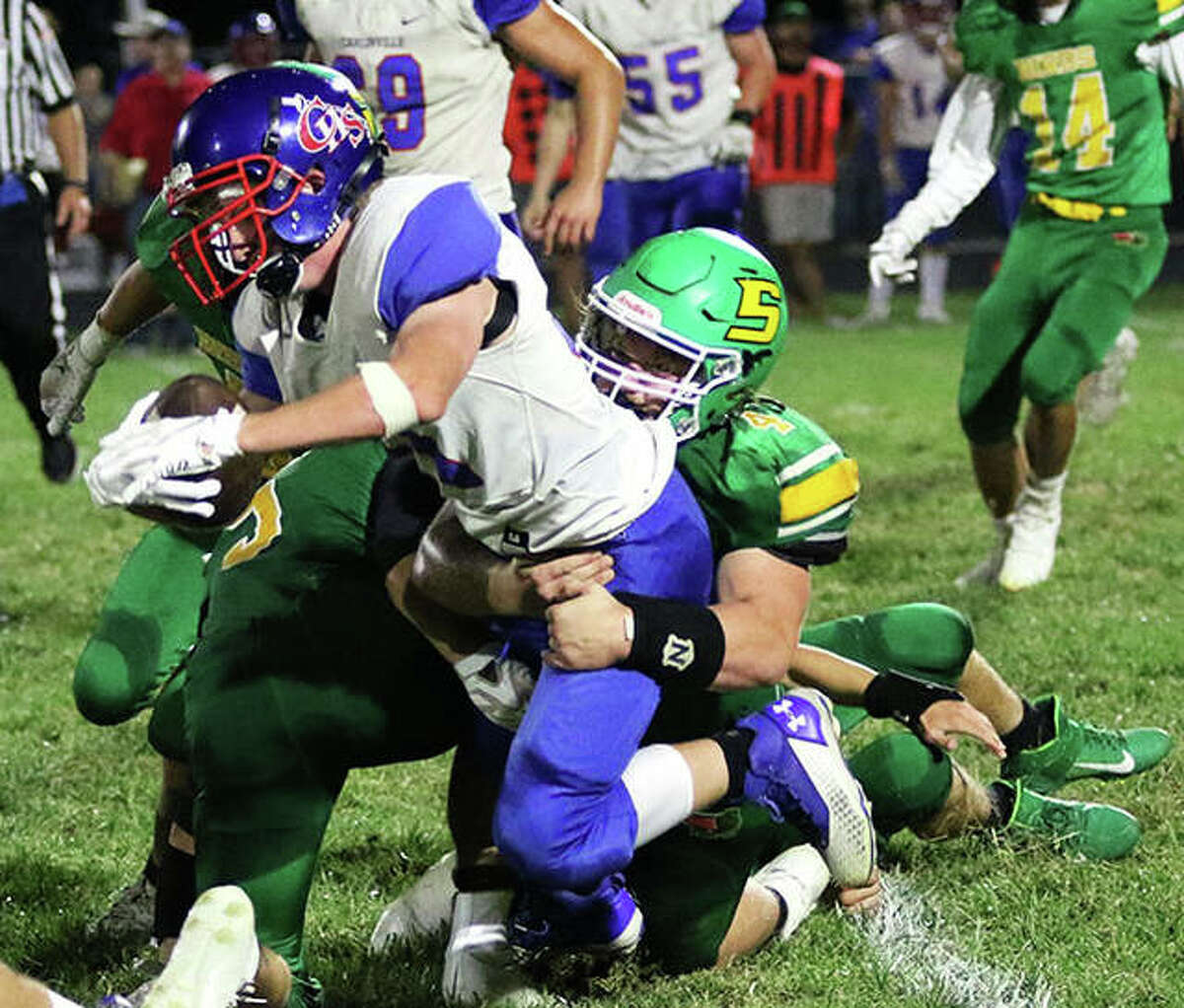 Carlinville's Jake Schwartz is tackled by Southwestern's Blake Funk in a South Central Conference football game Friday night at Knapp Field in Piasa.