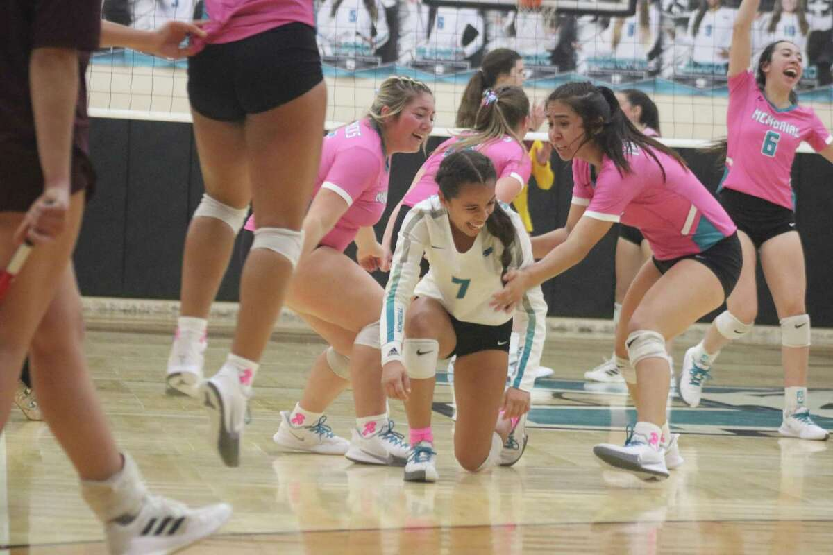 Teammates help Memorial libero Aleyna LeBlanc off the floor after she contributed to Memorial scoring game point in a crucial Game 4 victory Friday night. That's Biance Burnett (6) in the background among the Lady Mavs celebrating.