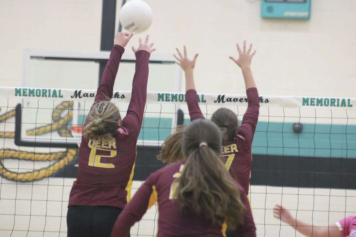 A Deer Park block keeps Memorial's offense at bay for a bit longer during the opening stages of Friday night's match.