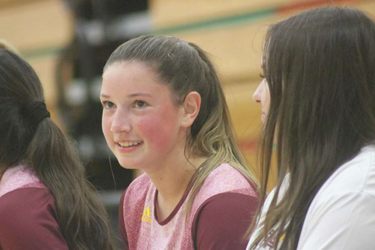Deer Park's Kayleigh Dyson gets a breather on the bench before returning to the floor to deliver some more strong passes to her hitters during Friday night's match that lasted two hours.