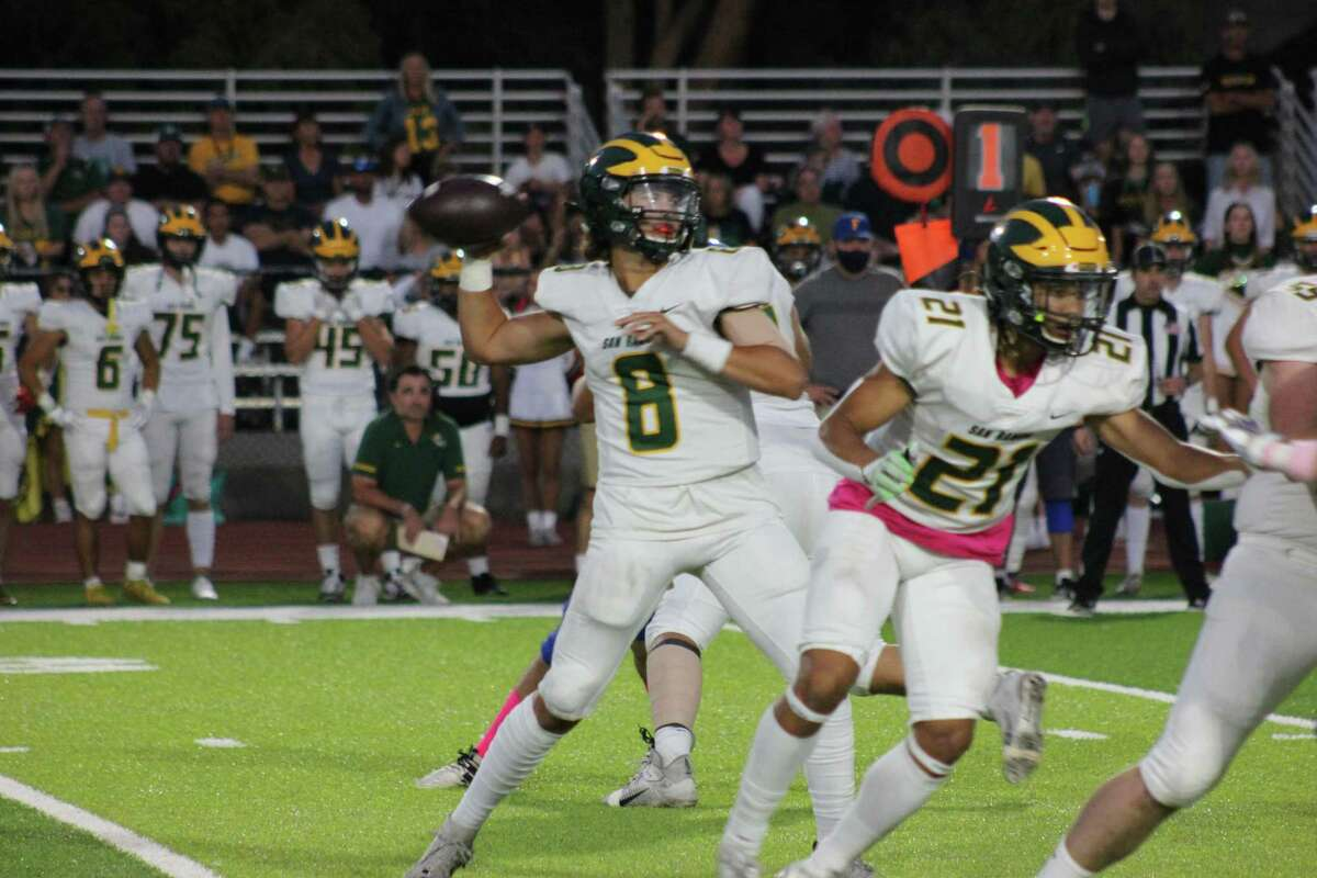 San Ramon Valley QB Jack Quigley drops back for a pass on the Wolves' game-opening drive. He was 10-for-11 passing for 141 yards and three scores.