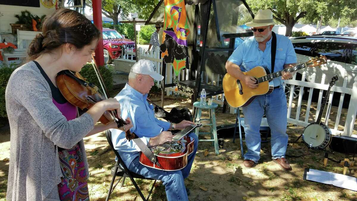 People play music in the Shade Tree Jam during a previous year's Bluegrass Tomball event.