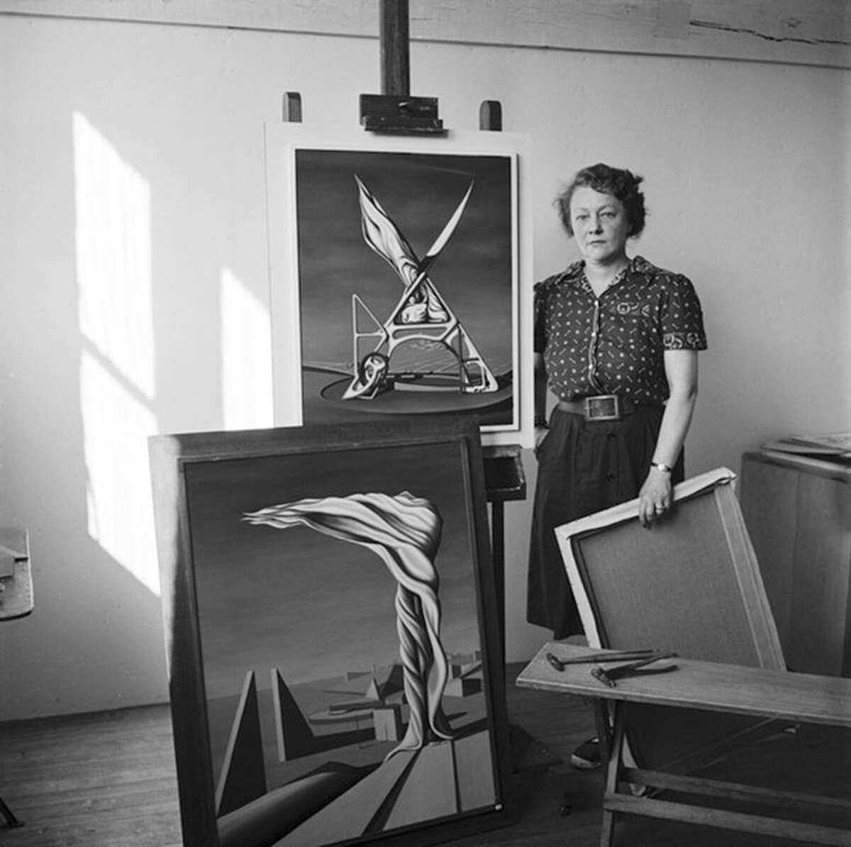 Kay Sage with her paintings