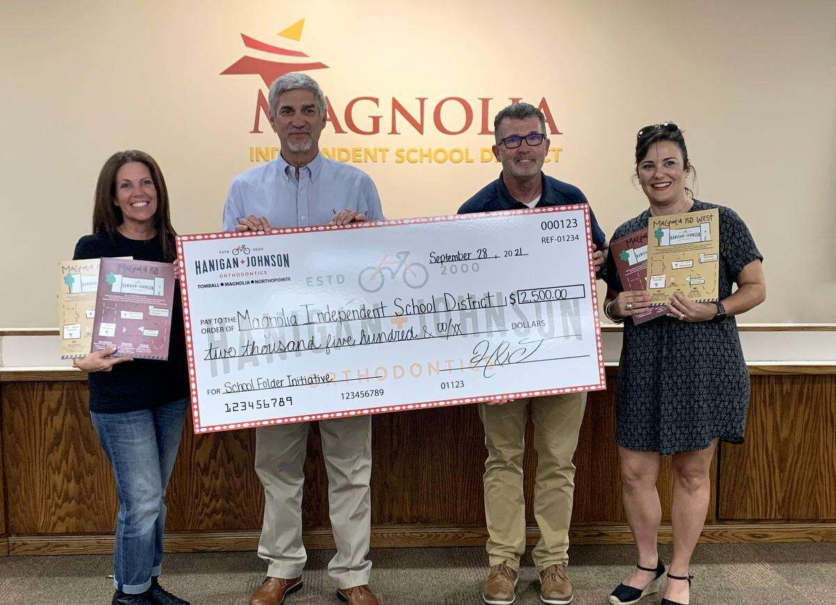 Local Orthodontists Dr. Hanigan and Johnson present a donation of $2,500 to the Magnolia Education Foundation.