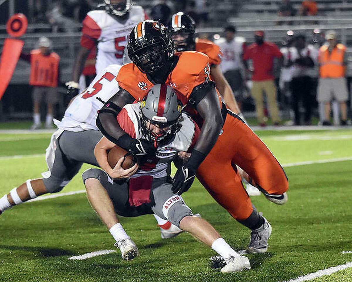 Edwardsville defensive tackle Nasim Cairo gets a sack during the second quarter on Friday in Edwardsville.