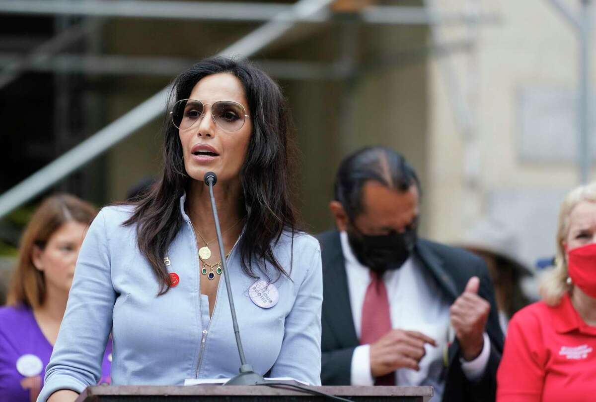 """Padma Lakshmi of Top Chef speaks during Houston Women's March at City Hall Saturday, Oct. 2, 2021 in Houston.The roster of speakers Saturday included celebrity chefs Padma Lakshmi and Gail Simmons, who are in Houston filming the upcoming season of """"Top Chef."""" They were accompanied by fellow """"Top Chef"""" judge Tom Colicchio, who stood offstage showing support."""