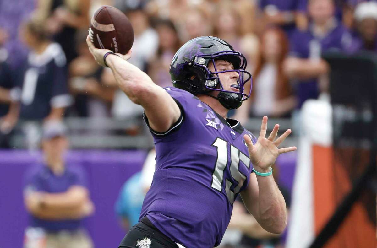 TCU quarterback Max Duggan (15) throws against Texas during the first half of an NCAA college football game Saturday, Oct. 2, 2021, in Fort Worth, Texas. (AP Photo/Ron Jenkins)