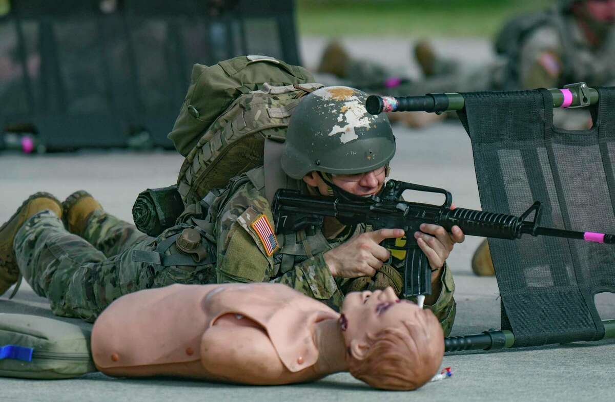 """An Army solider """"shoots"""" before advancing to tend to the wounded during medic training at Joint Base San Antonio-Fort Sam Houston on Aug. 17, 2021. Defense Secretary Lloyd Austin recently issued a memo ordering mandatory coronavirus vaccinations for all U.S. service members."""