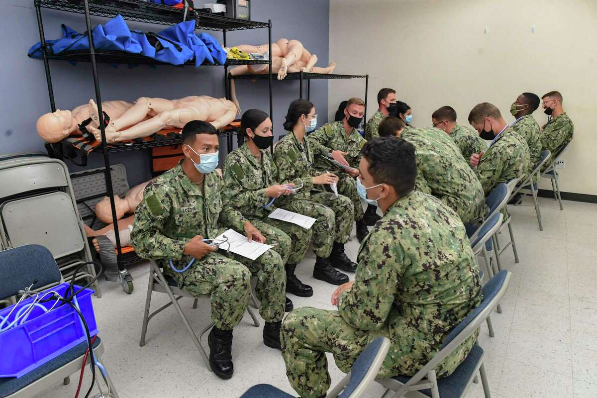 U.S. Navy personnel training to be corpsmen gather in a lab at Joint Base San Antonio-Fort Sam Houston on Aug. 17, 2021. Navy corpsmen are often assigned to Marine units.