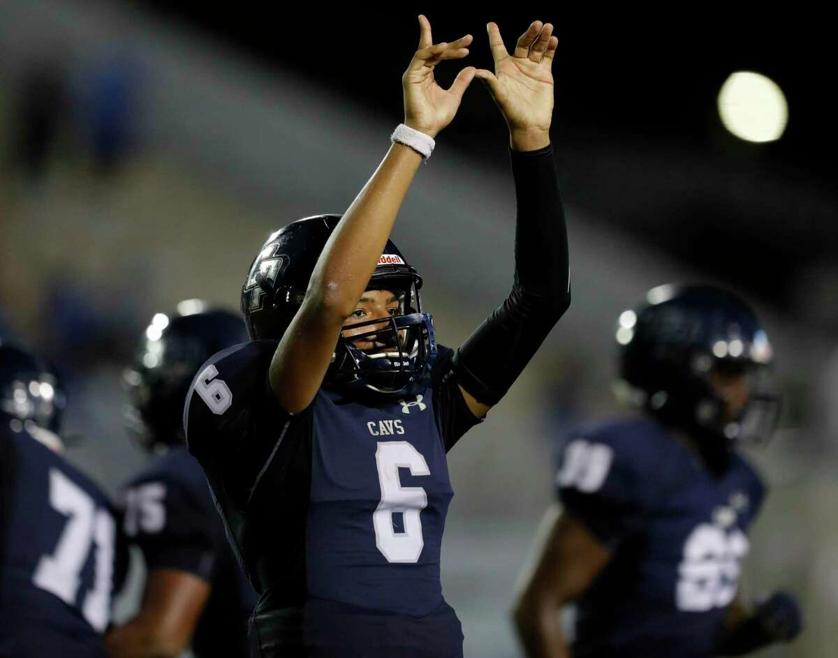 College Park quarterback Ty Buckmon reacts toward the student section during the fourth quarter of a game at Woodforest Bank Stadium on Sept. 18 in Shenandoah.