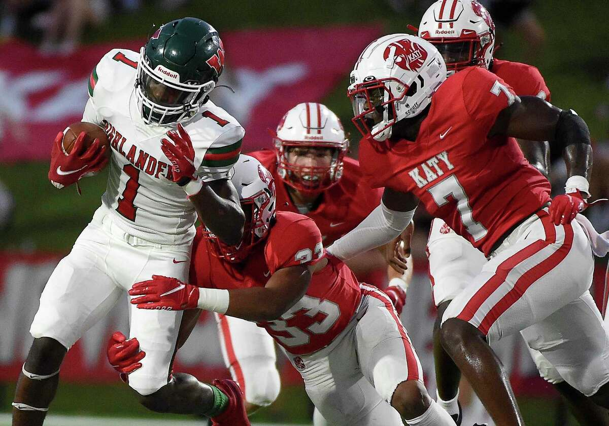 The Woodlands running back JoBarre Reed (1) is tackled by Katy linebacker Damian Neveaux (33) during the first half of a high school football game, Thursday, Sept. 16, 2021, in Katy.