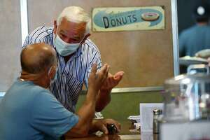 Customers including Stamford resident Joseph Agostino chat with Bobby Valentine who is running unaffiliated in his campaign for mayor Saturday morning, August 13, 2021, at Bedford Street Diner in Stamford, Conn.