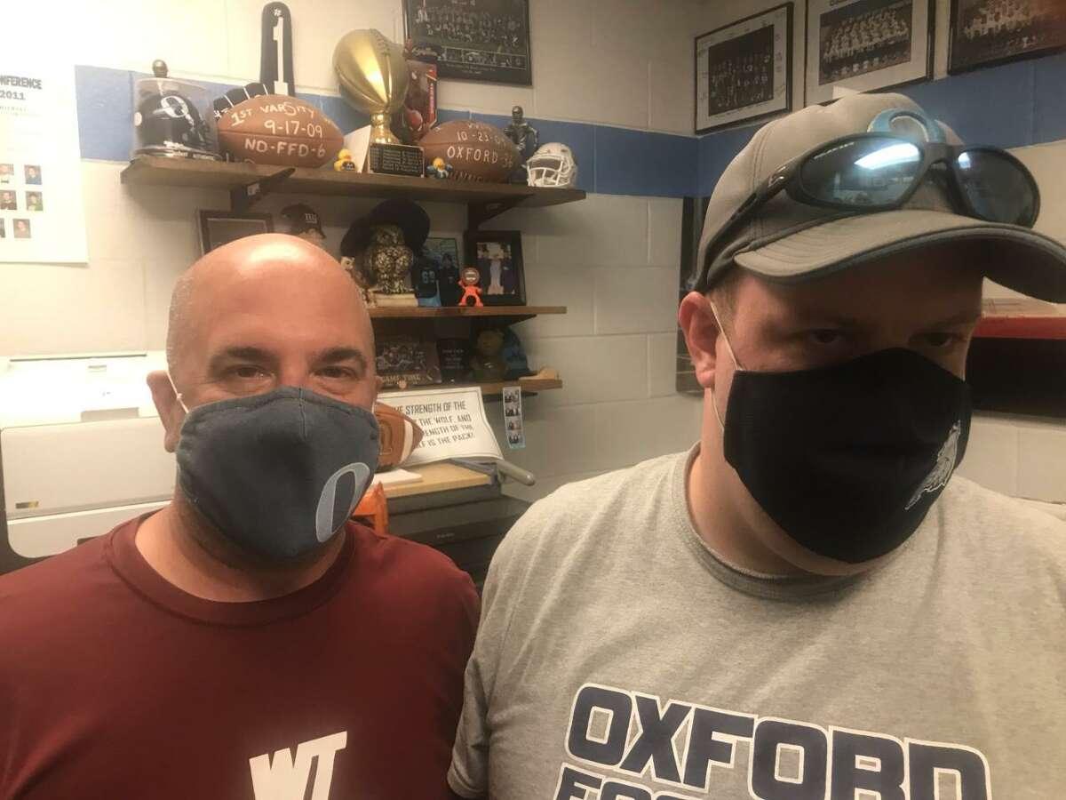 Oxford head coach Joe Stochmal and assistant coach Ryan Tuttle.