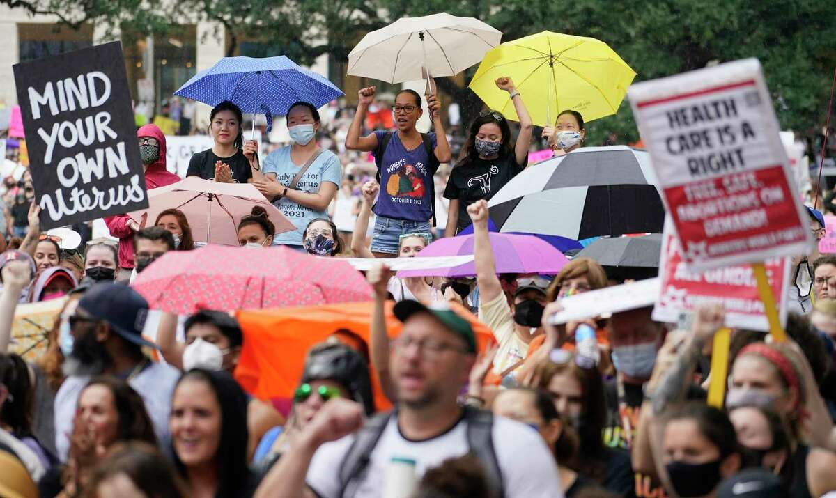 People participating in the Houston Women's March against Texas abortion ban listen to speakers at City Hall Saturday, Oct. 2, 2021 in Houston.
